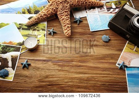 Beautiful composition with sea accessories and camera on table close up