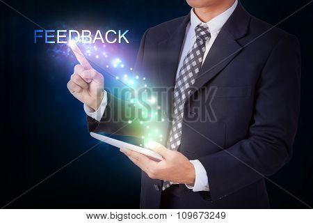 Businessman holding tablet with pressing feedback. internet and networking concept