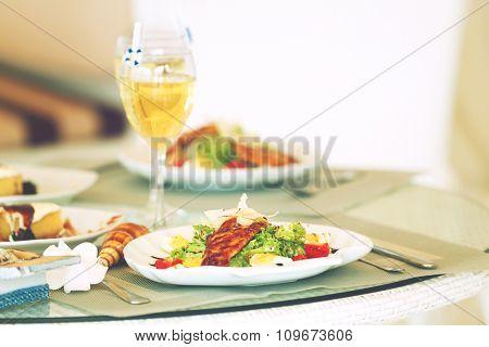 Tasty salad on white served table