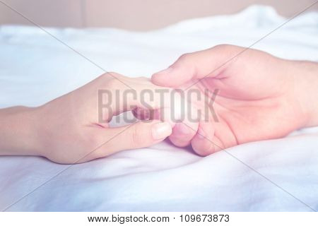 Male and female hands on light background
