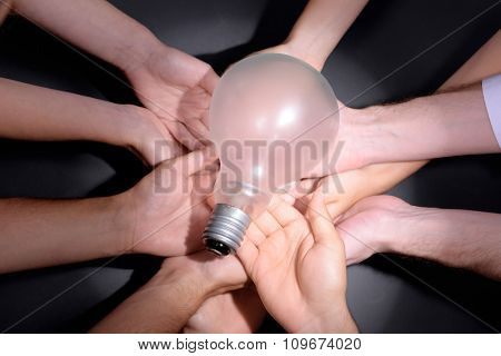 Light bulb in hands, closeup