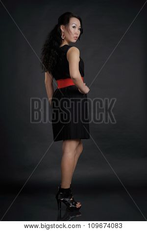 Portrait of woman in black dress