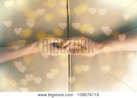 Male and female hands on bright background