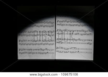 Note holder against musical instruments on wooden background, close up