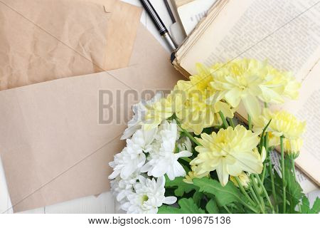 Papers with beautiful bouquet of flowers, close up