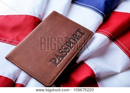 Passport lying on American Flag background
