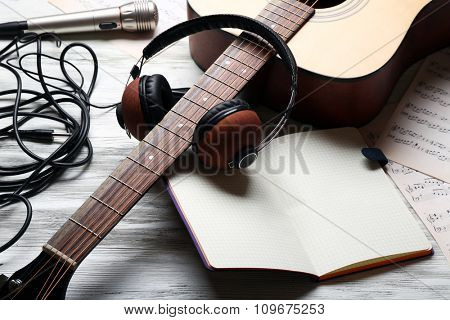 Musical equipment on grey wooden background
