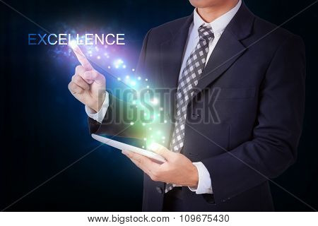 Businessman holding tablet with pressing excellence. internet and networking concept