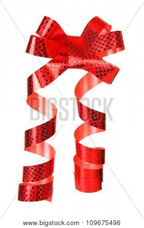 Hand holds red shiny bow with curved ribbon isolated on white background
