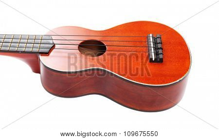 Body part of the Hawaiian acoustic guitar isolated on white