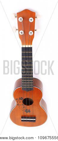 Beautiful Hawaiian acoustic guitar isolated on white
