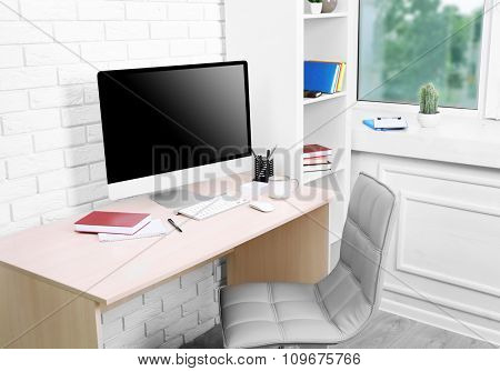 Workplace with computer in office