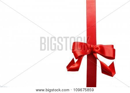 Vertical ribbon with bow, isolated on white