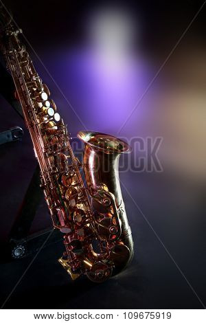 Beautiful golden saxophone on a scene, close up