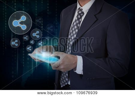 Businessman hand touch screen database circular icons on a tablet.