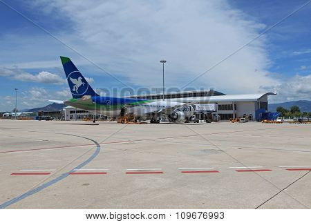 NHA TRANG, VIETNAM - SEP 13, 2014: A passenger airplane landing on Nha Trang International Airport in Khanh Hoa province. Nha Trang is one of the most attractive address for tourist in the world.