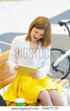 Young Woman With Tablet Pc In The Park