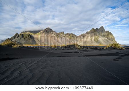 Mountains And Volcanic Lava Sand In Stokksness, Iceland