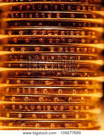 golden dollar coins stack, macro view