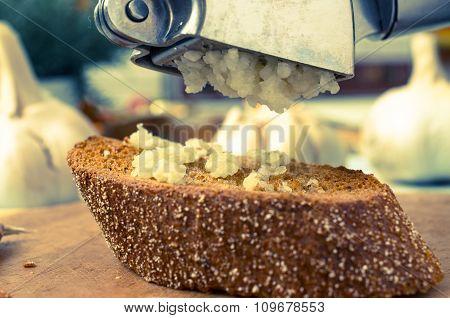 Appetizer Of Garlic Pressing Garlic Press