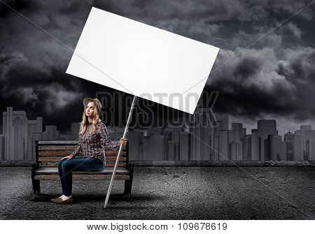 Teenager with banner