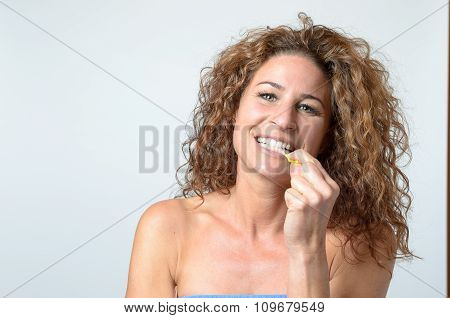 Woman Cleaning Her Teeth With An Interdental Brush