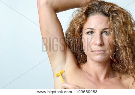 Woman Shaving The Hairs Under Her Armpit
