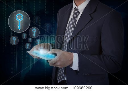 Businessman hand touch screen key icons on a tablet.