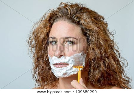 Woman Shaving Her Beard