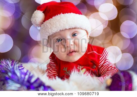 Baby boy in santa costume for Christmas