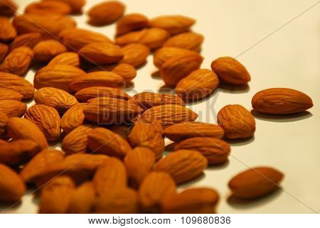 Peeled kernel almonds in bulk close up in bulk as background
