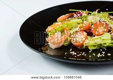 perfect dish with shrimps on a black plate. seafood