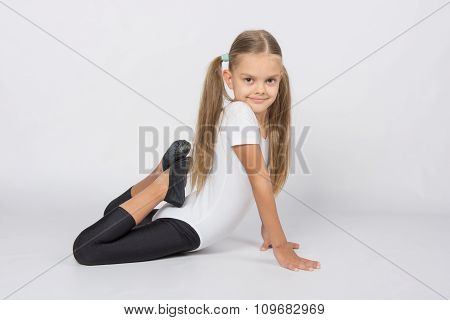 Girl Gymnast Performs An Exercise Fish