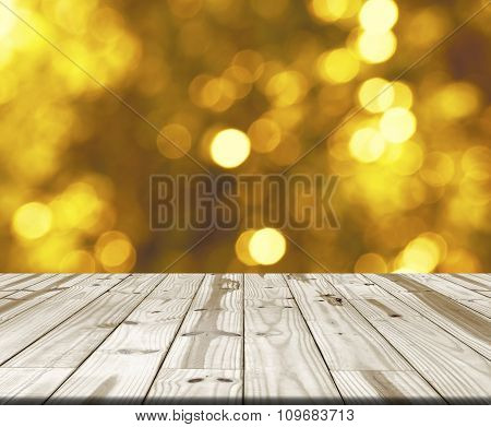 Wood table top on blurry yellow bokeh light i