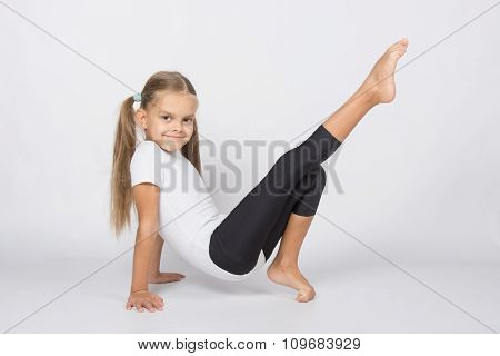An Aspiring Gymnast Pulls His Right Leg Resting On The Hands And Fingers Of The Left Leg