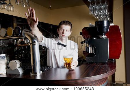 Young Handsome Bartender Waiting An Order.