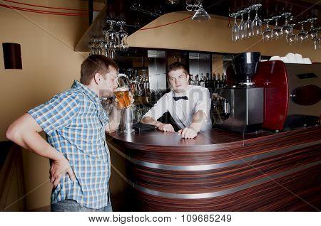 Man Tasting Beer At The Bar