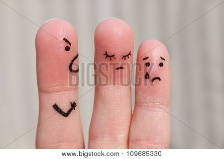 Finger art of family during quarrel. The concept of man scolds his wife and child, woman is sad, bab