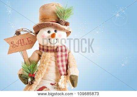 Snowman Holding Sale Arrow Sign