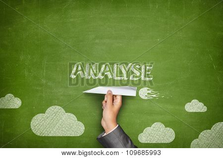 Analyse concept on blackboard with paper plane