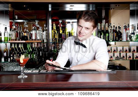 Young Smiling Bartender Taking An Order.