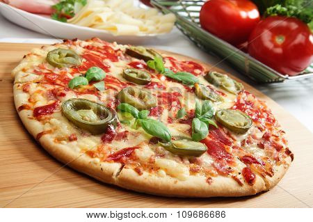 Pizza With Cheese, Ham And Jalapeno Pepper