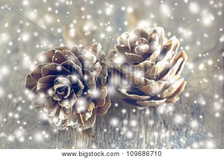 Christmas Background With Christmas Decoration.pine Cones With Falling Snow Flakes.