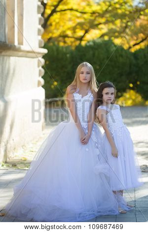 Two Girls In White Dresses