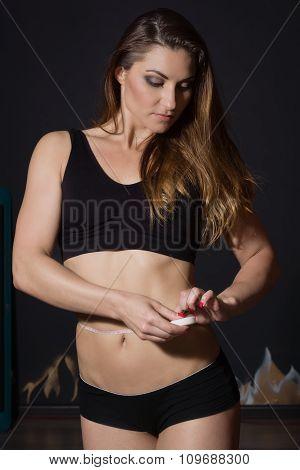 Woman Measuring Perfect Shape Of Beautiful Thigh