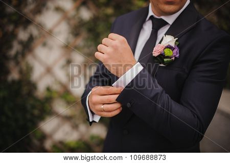 man on his wedding day in  suit