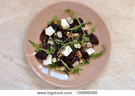 Beet salad with dried plums, walnuts. feta cheese and arugula