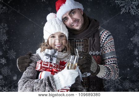 Happy Christmas Couple With Glasses  And Gifts Covering  Snow Background