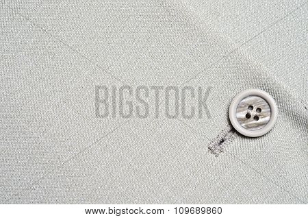 grey button on jacket
