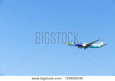 The Airplane Is Flying In Blue Sky